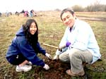 Father daughter planting